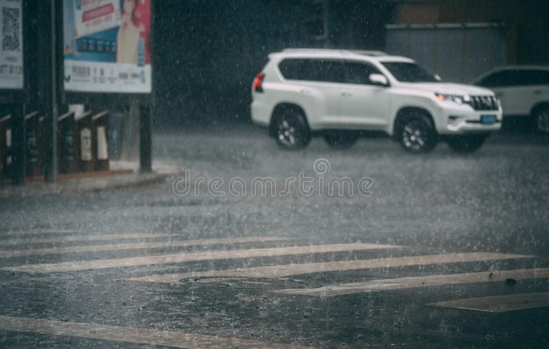 Tropical monsoon rain in Chengdu. Zebra crossing full of water during tropical monsoon rain in Chengdu, Sichuan province, China royalty free stock image
