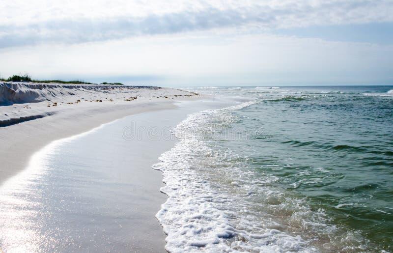 Tropical ocean beach landscape scene. Beautiful scenic tourist travel destination location. Relaxing Gulf Coast seaside beaches royalty free stock image