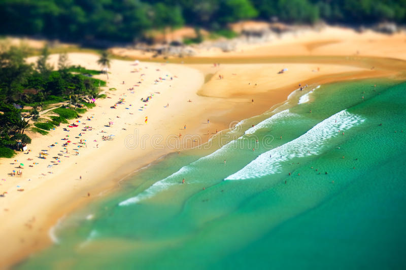 Tropical ocean beach landscape tilt shift effect. Phuket, Thailand. Tropical sandy beach landscape from high view point tilt shift effect. Beautiful turquoise royalty free stock photo