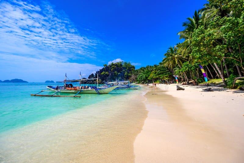 Tropical Papaya beach at paradise coast, El Nido, Palawan, Philippines. Tour A Route. Coral reef and sharp limestone cliffs.  royalty free stock photography