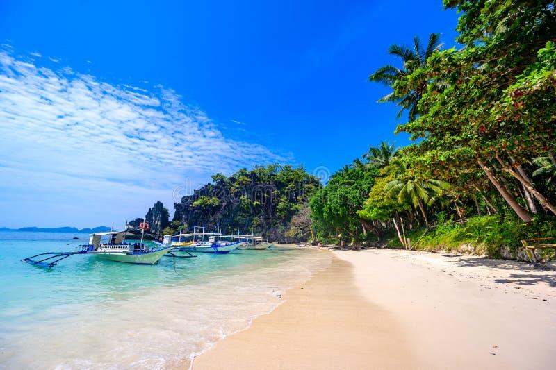 Tropical Papaya beach at paradise coast, El Nido, Palawan, Philippines. Tour A Route. Coral reef and sharp limestone cliffs.  royalty free stock image