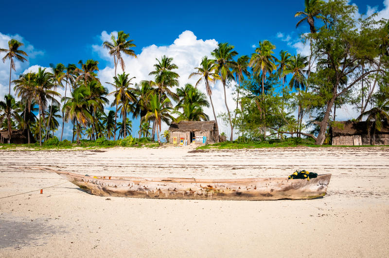 Tropical Paradise. A fishing boat deserted on a beach on the tropical island of Zanzibar, Africa royalty free stock photo