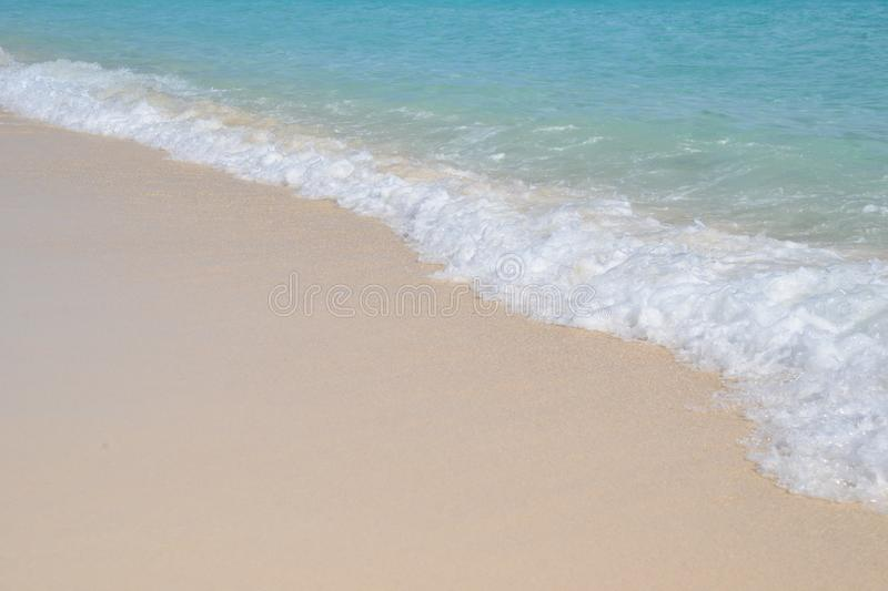 Tropical paradise, small waves breaking on a crystal clear beach. stock photos