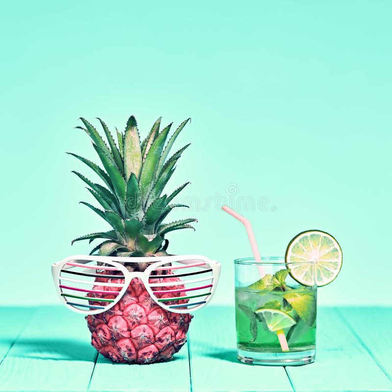 Tropical Pineapple on Beach. Bright Summer Color stock images