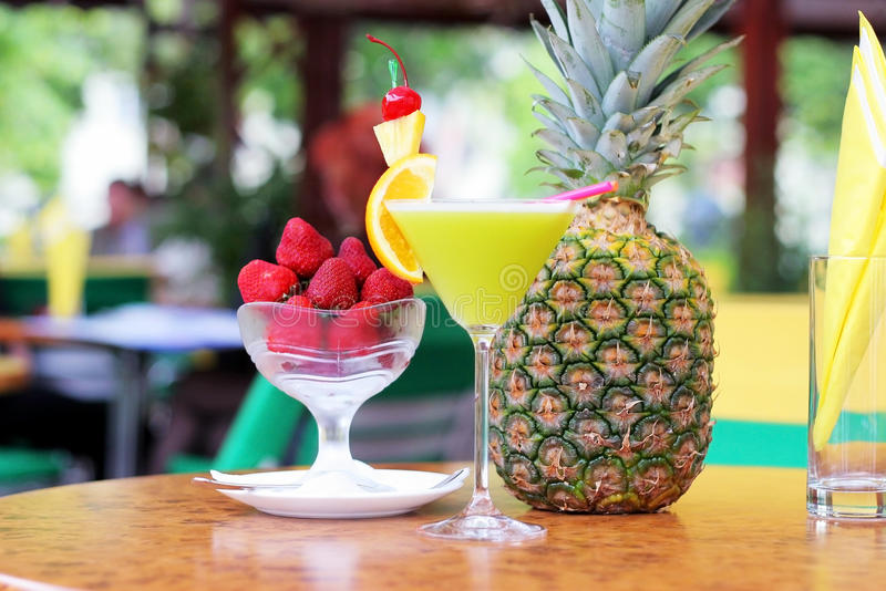 Tropical pineapple cocktail. With strawberries stock image