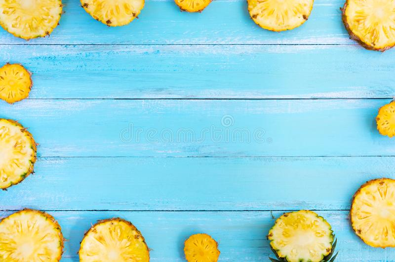 Tropical pineapple on wood plank blue color. stock photos