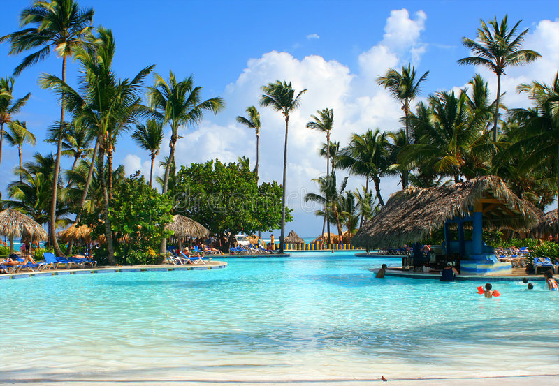 Tropical pool bar. With families enjoying their vacation at a Caribbean resort royalty free stock photography