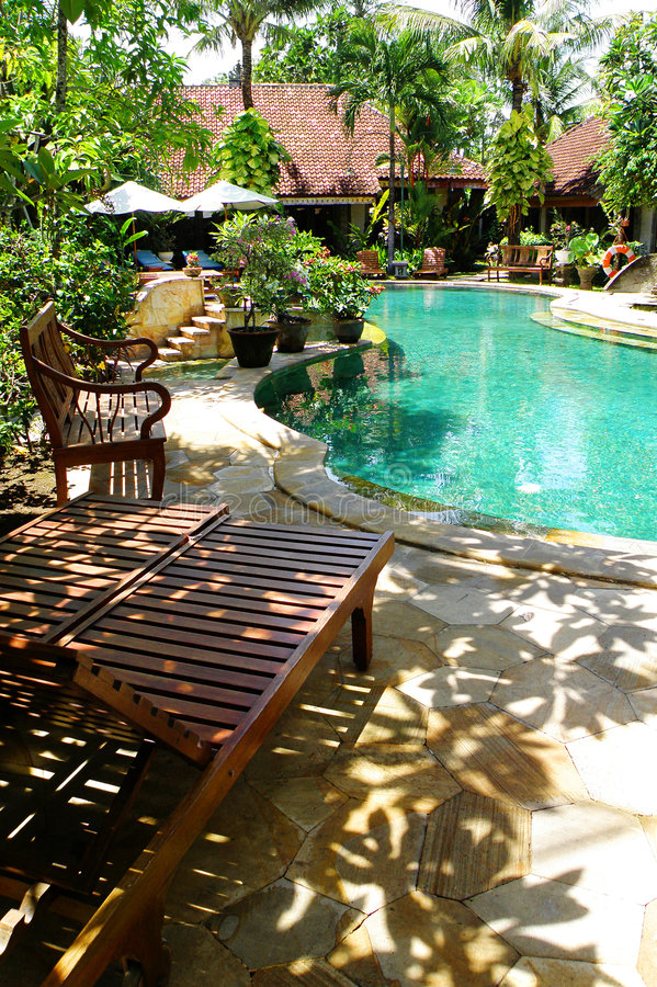 Download Tropical Resort Landscaping, Pool Side Chairs Stock Image - Image: 7839651