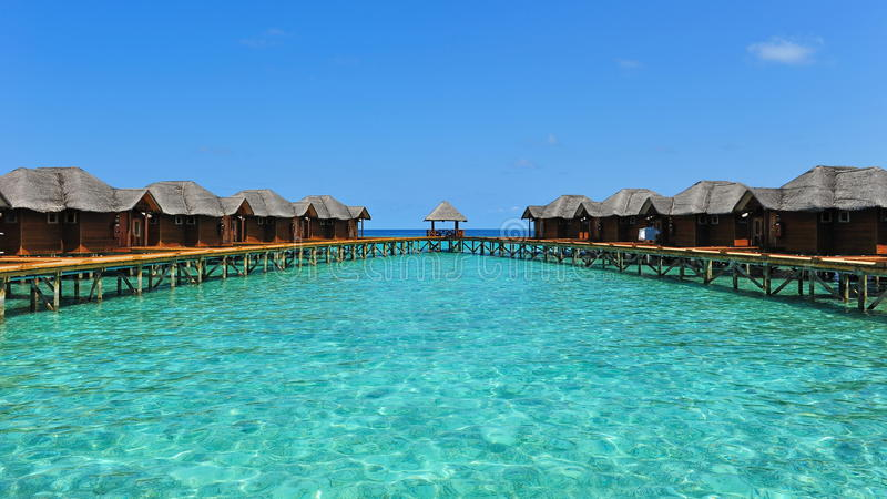 Tropical resort with water bungalows in Maldives royalty free stock image