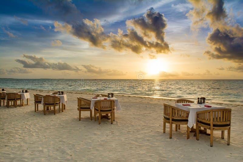 Tropical restaurant on the sandy beach royalty free stock photo