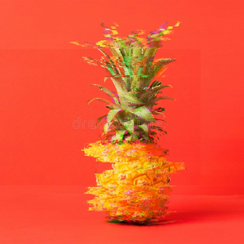Tropical ripe pineapple on a bright trendy coral background. Summer creative concept. Glitch effect. Square frame stock image
