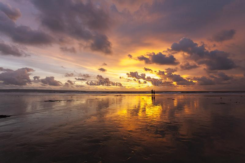 Tropical sandy beautiful beach of Kuta in Bali at sunset. Indonesia stock photography