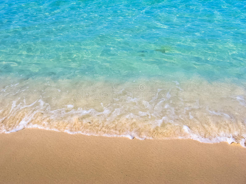 Tropical sea background. Close up of tropical and clear water of the Caribbean beach of Canto de la Playa, Saona Island, Dominican Republic. Sea and shore royalty free stock photo
