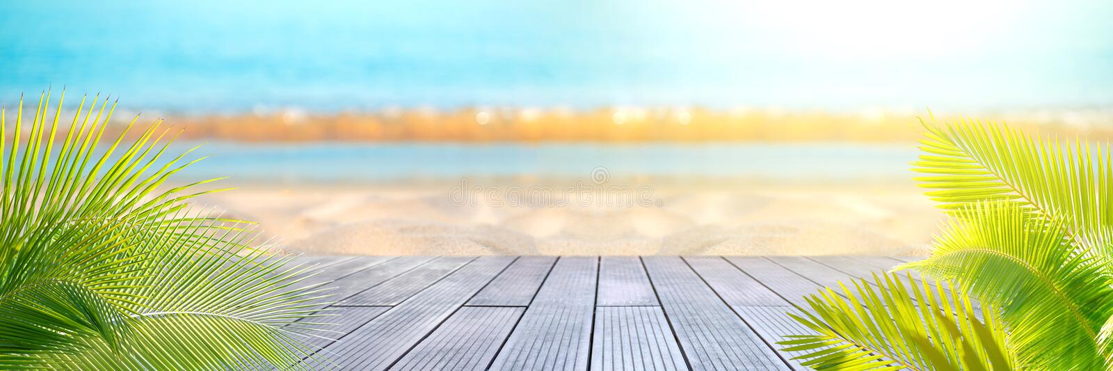 Tropical sea beach with sand, ocean, palm leaves and blue sky.  royalty free stock photos