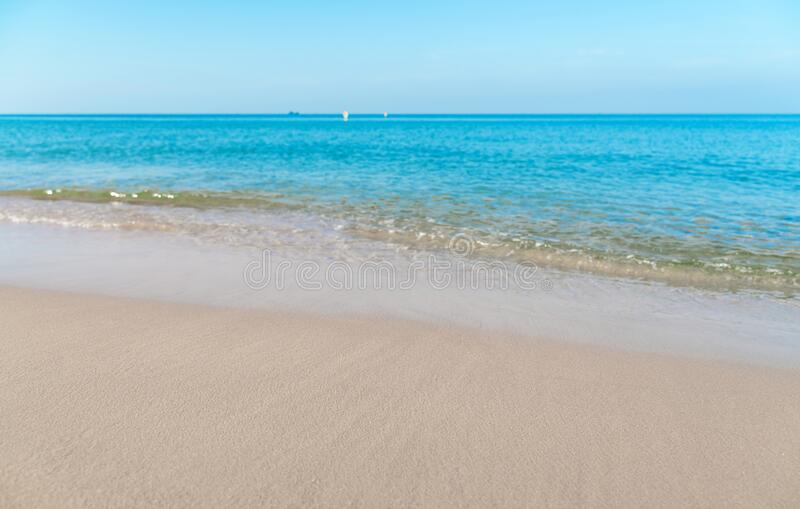 Tropical sea beach with sand and wave of the sea.  royalty free stock photos