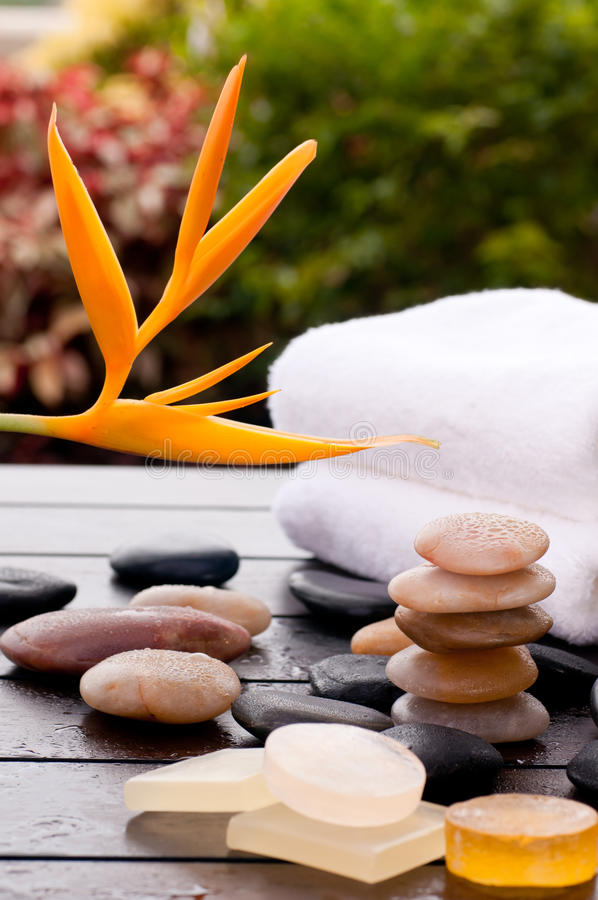 Tropical spa massage with zen stones and towels royalty free stock photos