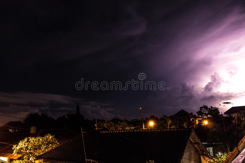 Tropical Storm clouds and Lightning at night on Bali island, Indonesia. stock photo
