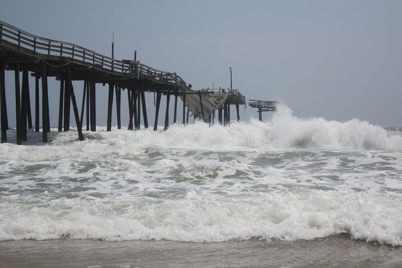 Download Tropical Storm Collides With The Frisco Pier Editorial Photography - Image: 20626562