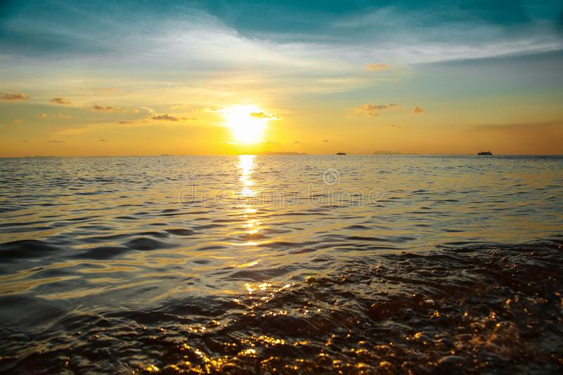 Tropical sunset beach. Beautiful background stock photo