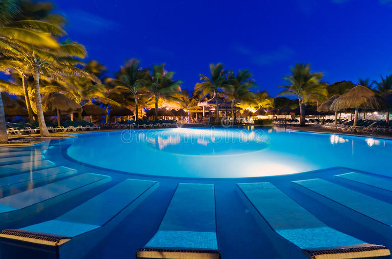 Download Tropical Swimming Pool At Night Stock Photo - Image: 20995716