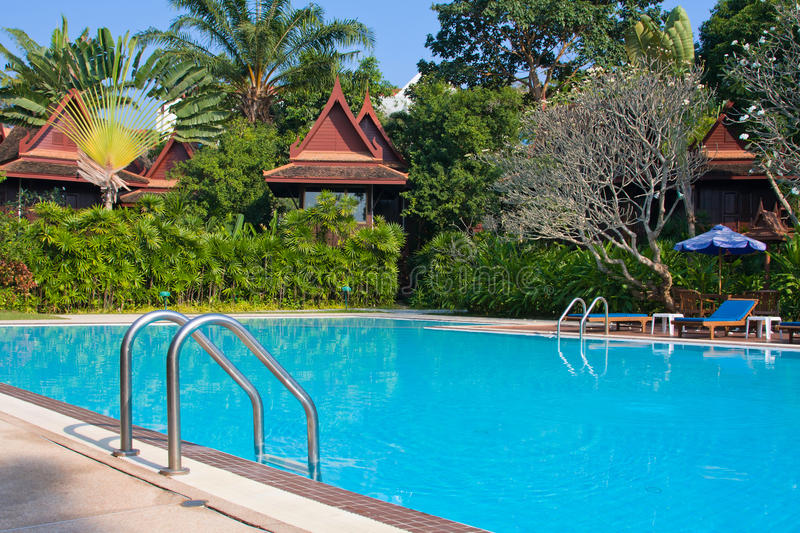 Tropical swimming pool in Thailand. Luxurious swimming pool in a tropical garden, Thailand stock photography