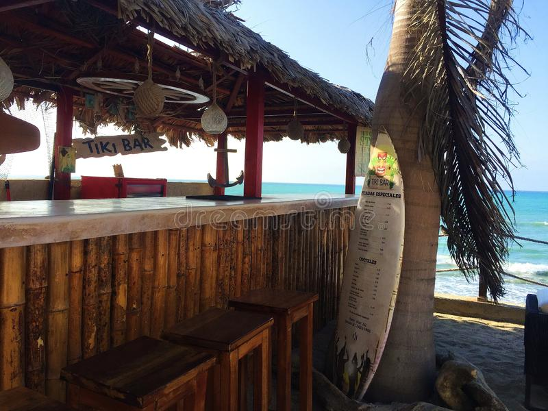 Tropical Tiki Bar on the Beach royalty free stock photos