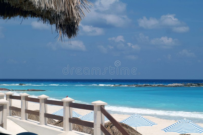 Tropical Tiki Hut. View of the Water from a Tiki Hut royalty free stock photo
