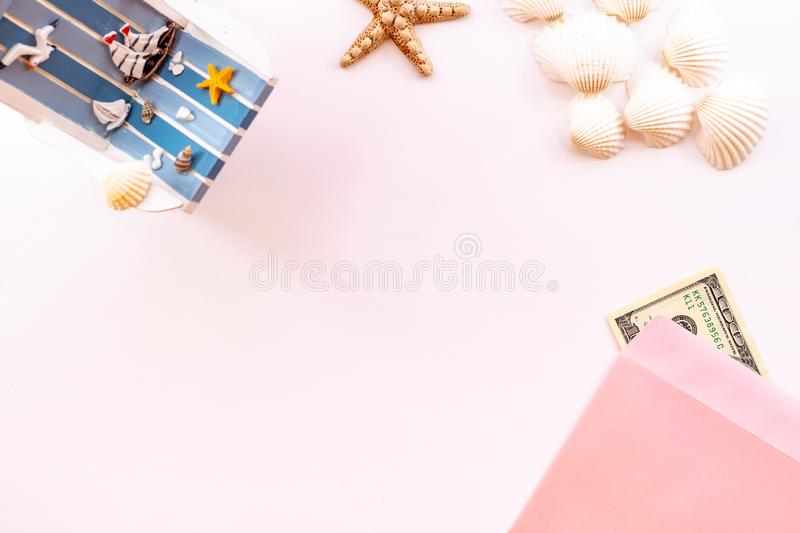 Tropical vacation background. Sea shells and starfish on a pink background.  Copy space, top view stock photography
