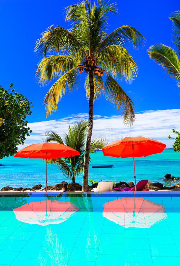 Tropical vacation - bar with turquoise swim pool and sea view. M stock image