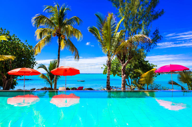 Tropical vacation - turquoise swim pool with sea view. Mauritius stock images