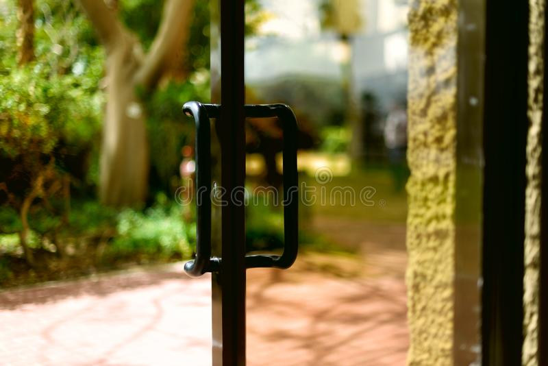 Tropical view background. Summer, travel, vacation and holiday concept. Open window, door and white curtain with blurred. Palm garden view from hotel. Exotic royalty free stock photography