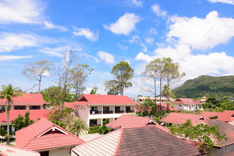 Tropical view over the red roof in a resort of Thailand with a beautiful sunny day royalty free stock image