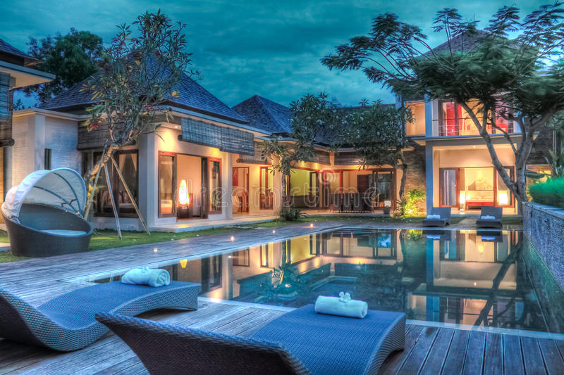 Tropical villa. A tropical luxury villa with swimming pool at dawn