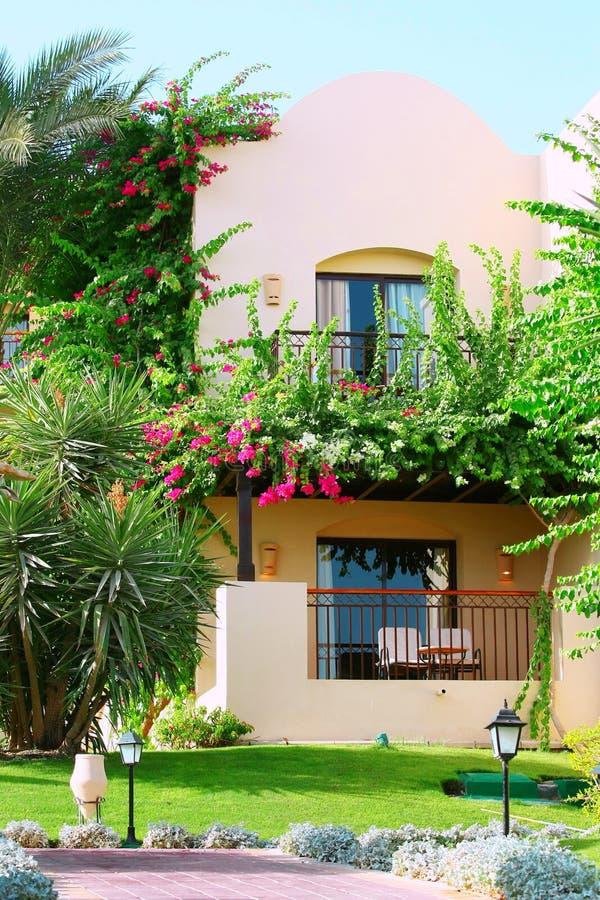 Tropical villa with garden. Tropical villa with beautiful garden royalty free stock photography