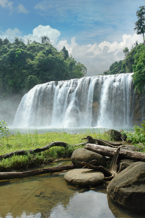 Tropical waterfall in jungle. stock images
