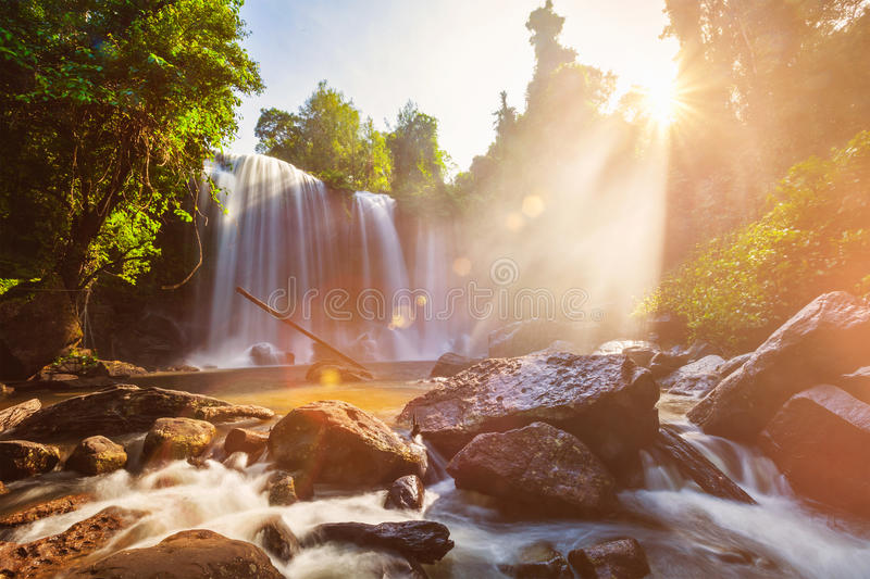 Tropical waterfall in the morning stock photography
