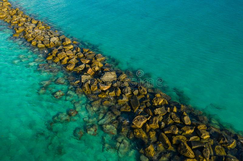 Tropical Waters and rock jetty. USA royalty free stock image