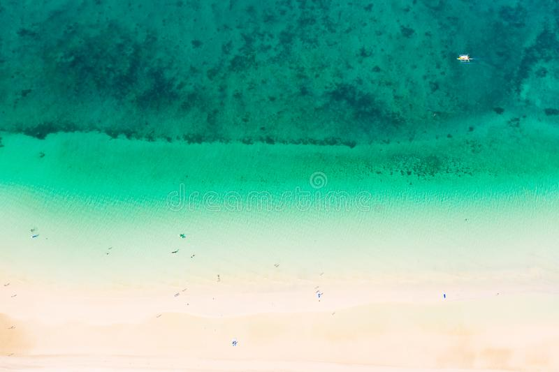 Tropical white sand beach from above.Beautiful aerial view of the beach and the blue sea. stock images