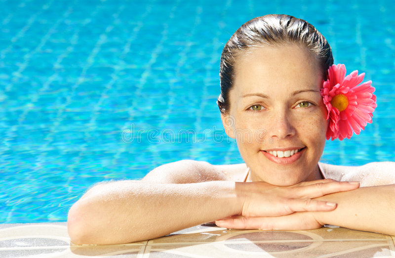 Tropical woman. Smiling woman at poolside