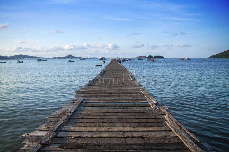 Tropical wooden pier in turquoise sea royalty free stock photos