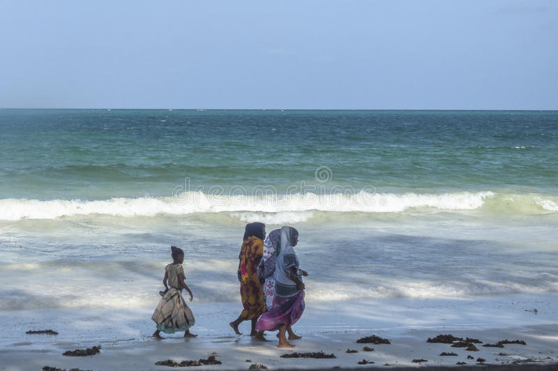 Tropical Zanzibar beach. Place on tropical beach in Kiwenga Village next to the Kiwengwa Beach resort on Zanzibar Island. Tanzania , Africa. Muslim woman on the royalty free stock image