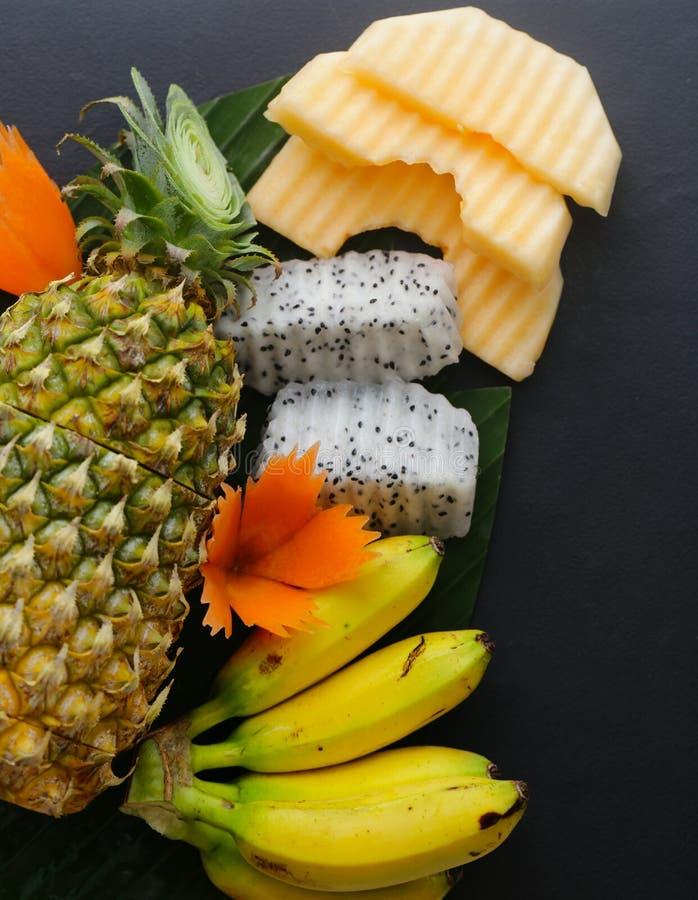 Tropische Früchte, Ananas, Banane stockfotos