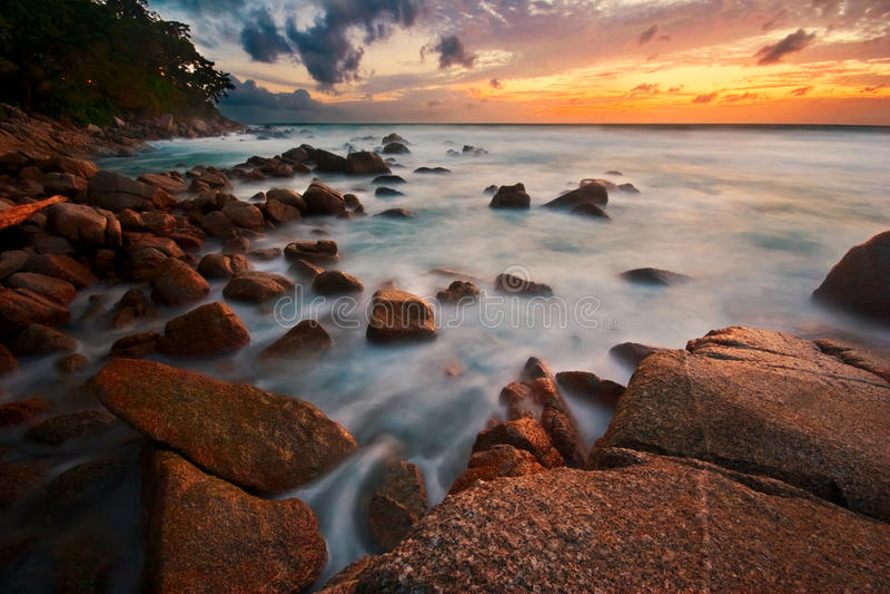 Tropische zonsondergang royalty-vrije stock afbeeldingen