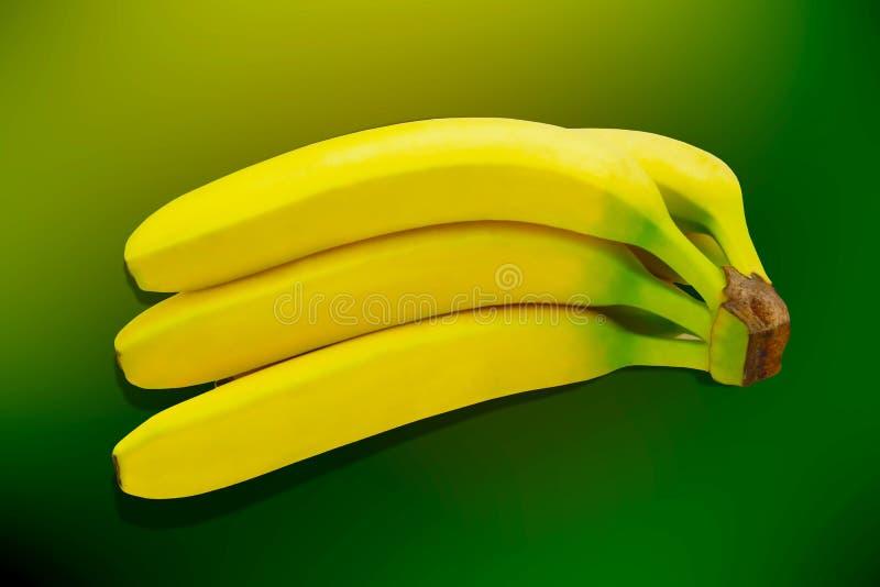 Tropisk gul bakgrund för Banane frukt isolerad natur royaltyfri foto
