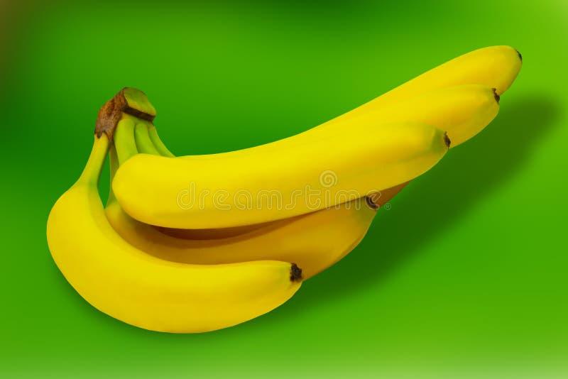Tropisk gul bakgrund för Banane fruktnatur royaltyfria bilder