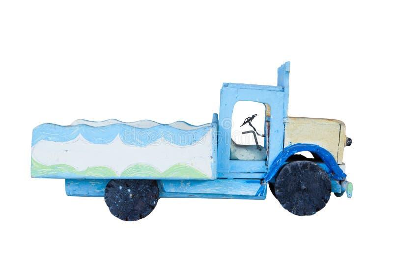 Troquez le véhicule fait à partir du fond blanc d'isolement vieux par bois images stock