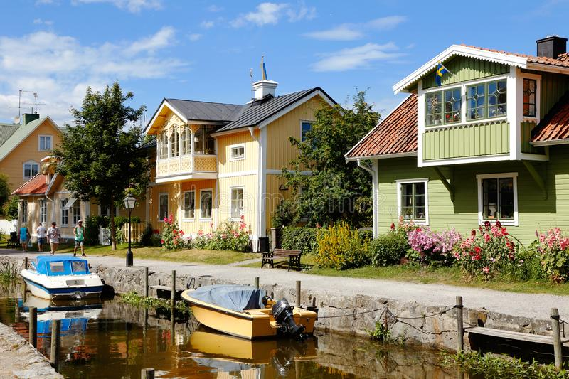 Trosa river. Trosa, Sweden - Juky 17, 2013: Family wooden houses alongside the river royalty free stock photo