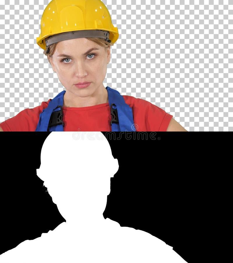 Trotse zekere jonge vrouwenarbeider met wapens op heupen, Alpha Channel royalty-vrije stock afbeelding