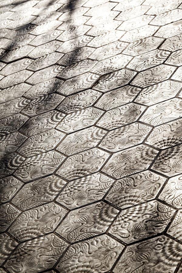 Trottoar med den Gaudi designen i Paseo de Gracia Avenue i Barcelon royaltyfria foton