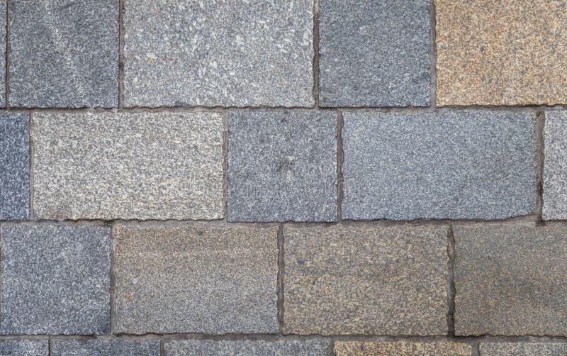Trottoartegelplattor, texturbakgrund Gray Square Pavement Seamless Tileable texturerar Den gamla stenläggningen belägger med tege royaltyfri fotografi